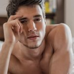 20-photodune-14951385-shirtless-sexy-male-model-lying-alone-on-his-bed-xl