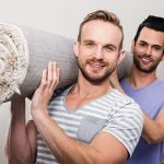 13-Gay-boys-moving-home-photodune-14766657-gay-couple-carrying-rolled-up-carpet-at-new-home-l