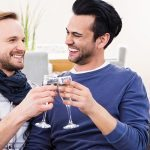20-photodune-16970356-gay-couple-toasting-on-the-couch-in-the-living-room-l