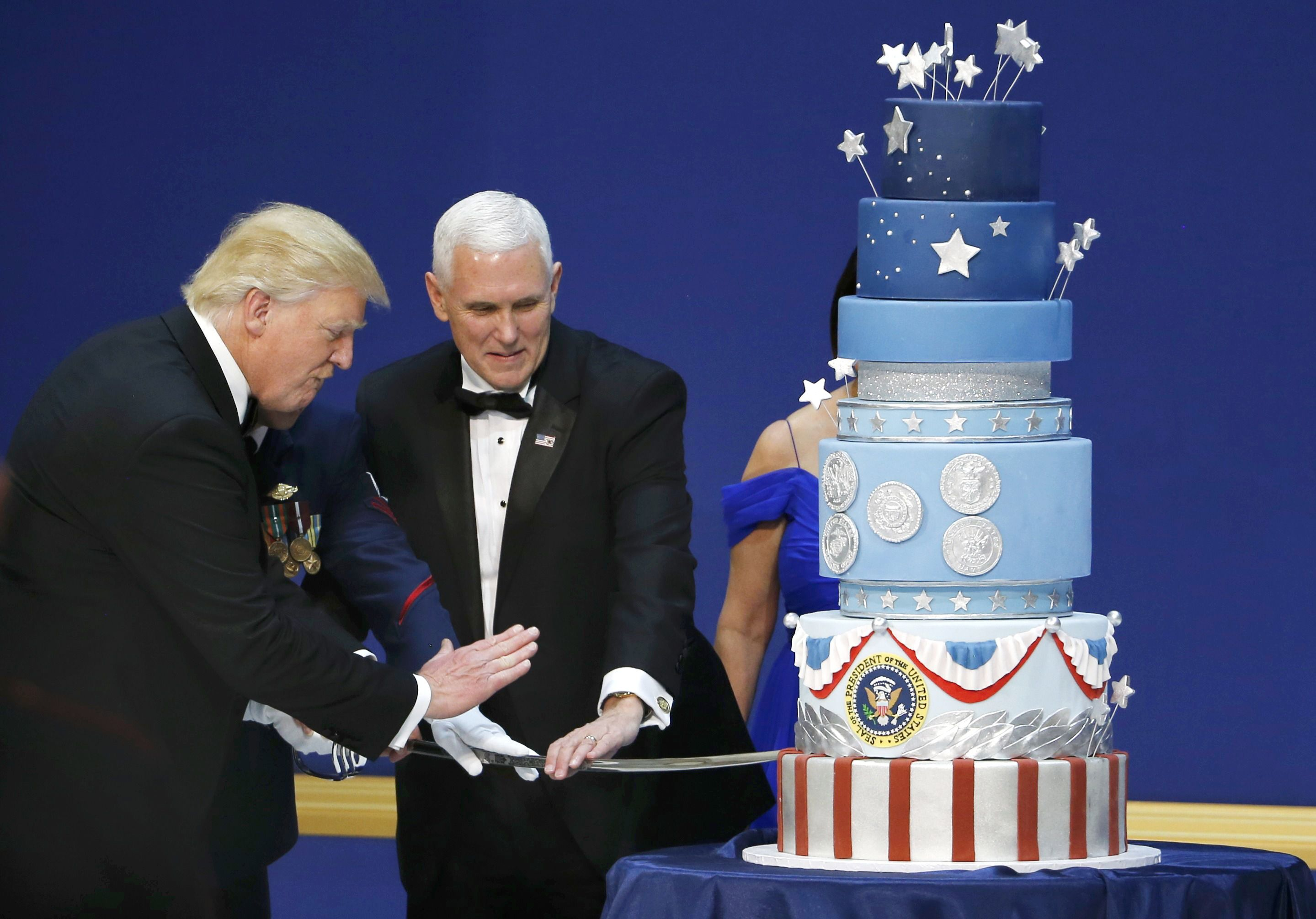 "U.S. President Donald Trump and Vice President Mike Pence prepare to cut a cake with a sword at the ""Salute to Our Armed Forces"" inaugural ball during inauguration festivities in Washington"